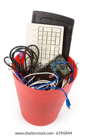 Red Garbage Can and  Discarded Computer Hardware - stock photo
