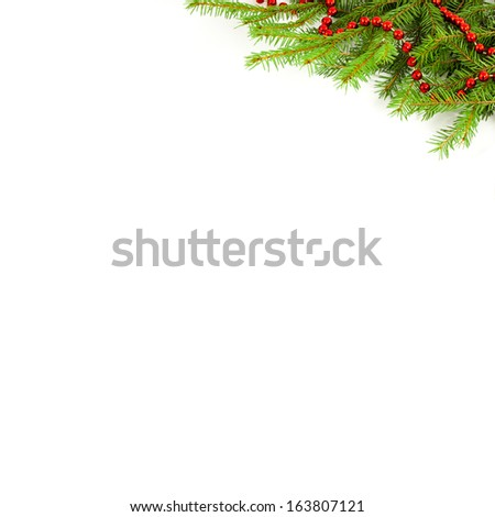Red garland on a Christmas tree on a white background - stock photo
