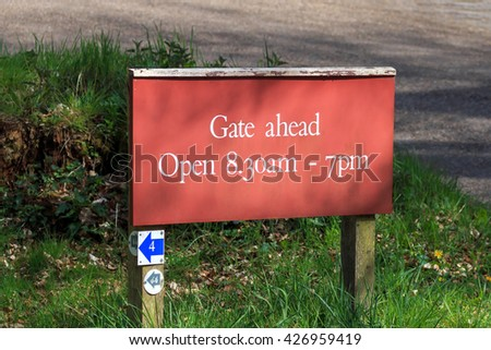 Red Gate ahead open 8 am to 7 pm sign - stock photo