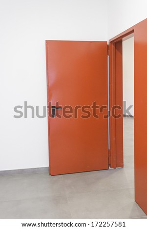 Red Gate corridor inside building, construction - stock photo