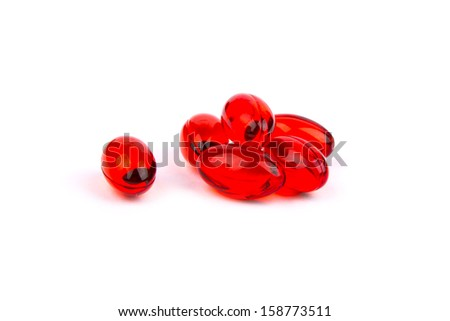 Red gel capsules. Selective focus. Isolated on white background. - stock photo