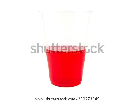 Red gelatin in a plastic cup isolated on white background