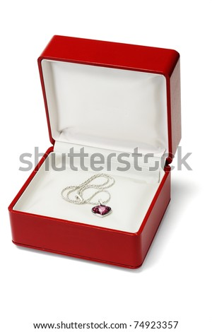 Red gemstone necklace in jewelry box on white background