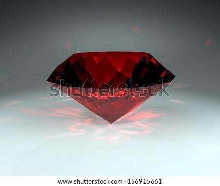 Red gemstone, ruby stone on the dark background - stock photo