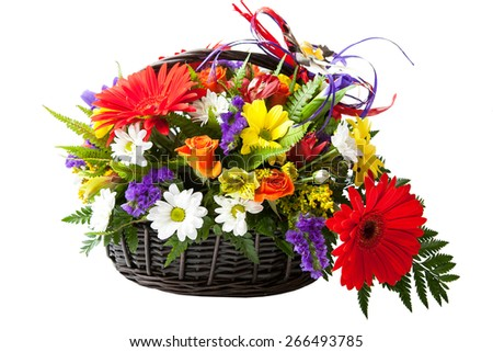 Red Gerbera flowers. beautiful bouquet of colorful spring flower in a basket.  - stock photo