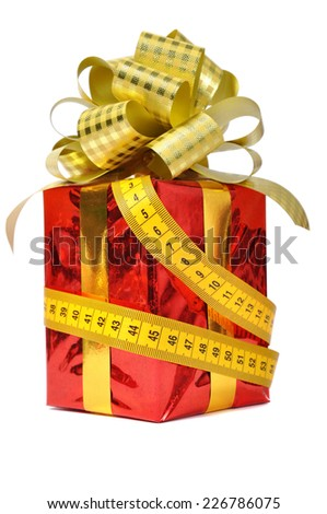 Red gift and measure tape over white - stock photo