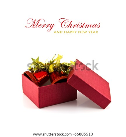 Red gift box and bell on white background with copy space. - stock photo