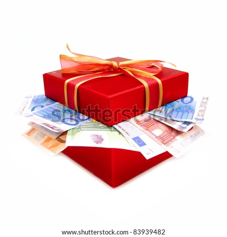 Red gift box and bow with money flowing out from inside - stock photo