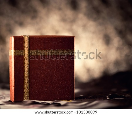 red gift box at dark background