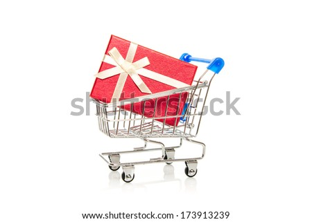 red gift box in steel shopping cart on white background