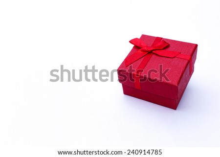 Red gift box on a white background. - stock photo