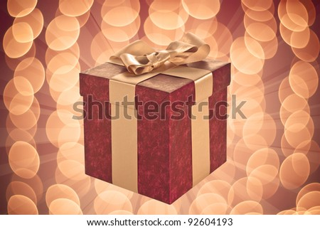 Red gift box on illuminated background