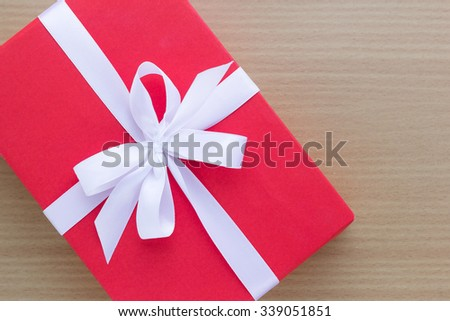 red gift box on table - stock photo