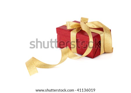 Red gift box with a gold bow on a white background - stock photo