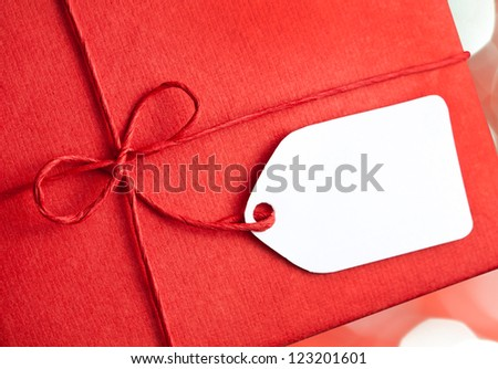 Red gift box with blank gift tag - stock photo