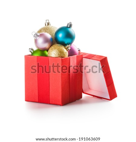 Red gift box with christmas balls on white background clipping path included - stock photo