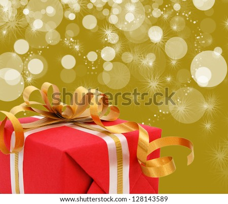 Red gift box with gift ribbon isolated on yellow background