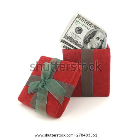 Red gift box with one hundred dollar bills. - stock photo