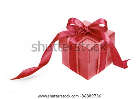 Red gift box with Pink ribbon on white background - stock photo