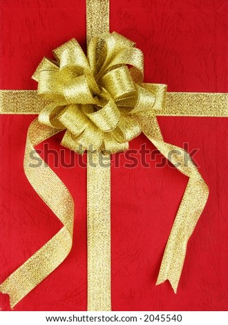 Red gift box with ribbon. - stock photo