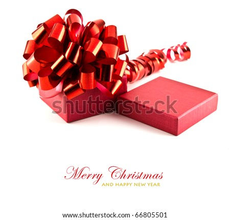 Red gift box with ribbon and bow on white background with copy space. - stock photo