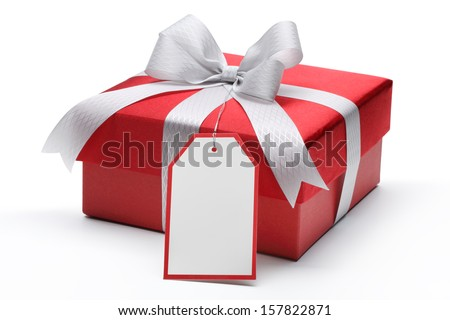 Red gift box with silver bow and tag - stock photo