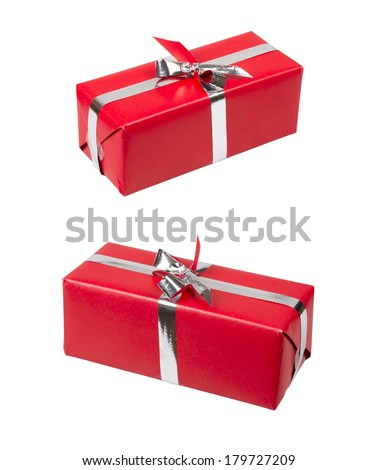 Red gift box with silver ribbon over white.