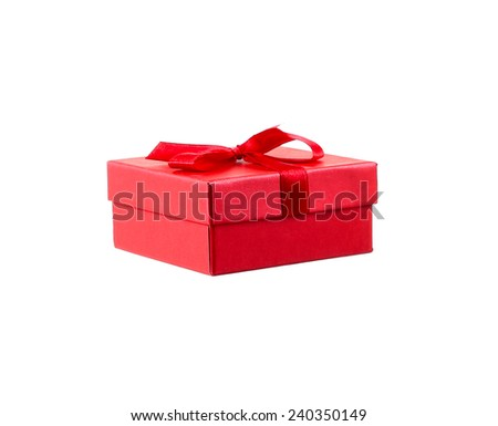 Red gift box with white ribbon isolated on red background. Clipping path included. - stock photo