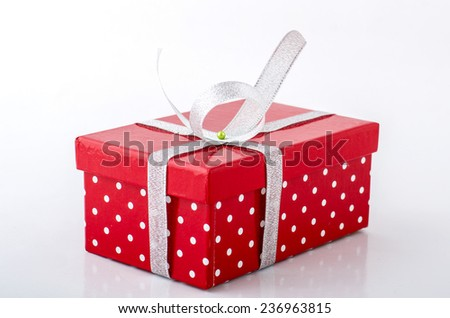Red gift box with white ribbon isolated on white background. Clipping path included. - stock photo