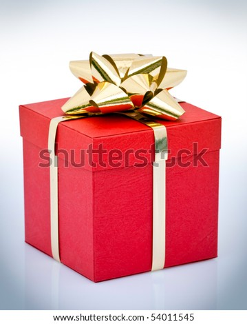 Red gift box wrapped with gold ribbon and bow. - stock photo
