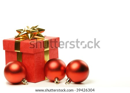 Red gift boxes and polished ball with ribbons isolated on white