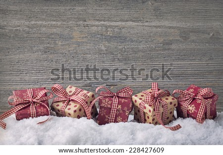 Red gift boxes on snow - stock photo