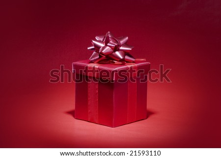 Red gift on red background