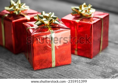 Red Gift on wooden table - stock photo