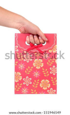 Red gift paper bag with flowers ptint. - stock photo