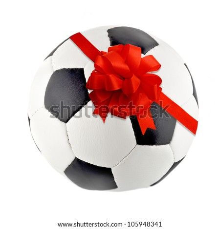 Red gift ribbon bow in soccer ball isolated on white background