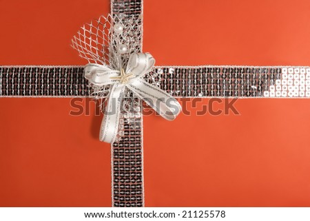 Red gift wrapping with silver ornaments (with clipping path) - stock photo