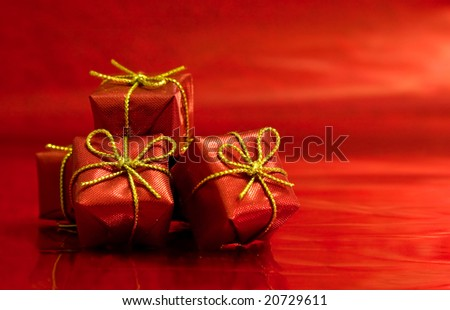 Red gifts on a red background. Close-up detail