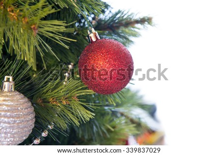 red glass balls on Christmas tree branch on white background