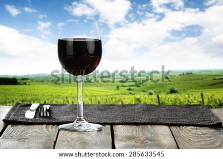 red glass of wine  - stock photo