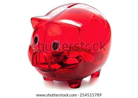 Red glass piggy bank filled with polish coins isolated on white background with clipping path - stock photo