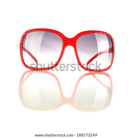 red glasses and blue glass on white space  - stock photo