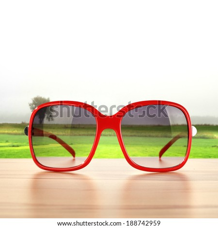red glasses and green landscape