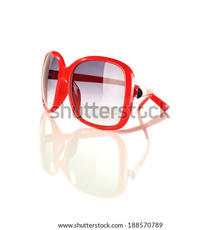 red glasses and white space  - stock photo