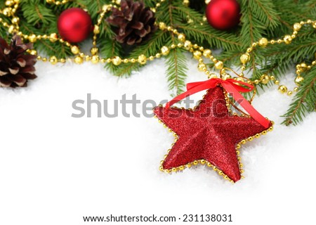 Red glitter Christmas star decoration and Christmas tree branch on white - stock photo