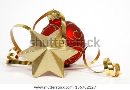 Red-golden bauble and golden star  - stock photo