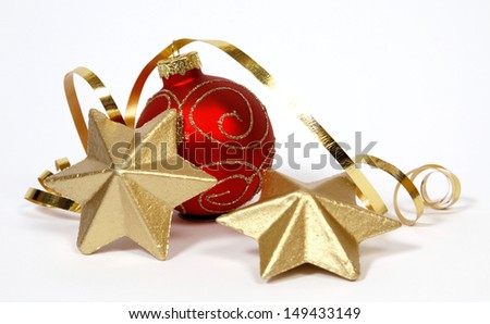 Red-golden bauble and golden stars on the white background