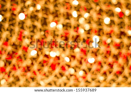 Red golden glowing background. Christmas card. Abstract background with bokeh defocused lights, stars, glare - stock photo