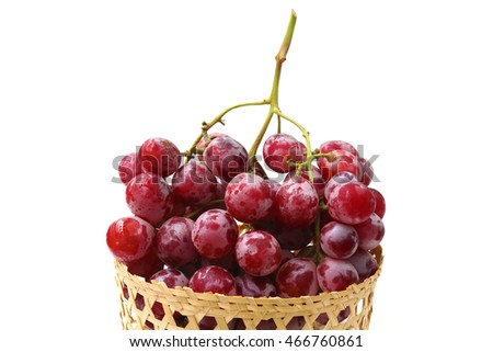 Red grape in basket on white background.