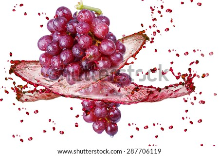 Red grape in splash on white background - stock photo